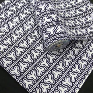 "A vintage, unused bolt of cotton fabric for making a yakuta (summer casual kimono) in a woven indigo and white color, using the special weaving technique of ""Koubai-Ji"", which has a subtle texture and is fully reversible. The pattern is a ""kikkou""."