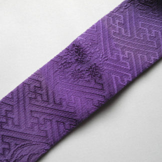 Rich purple silk Kasane-eri with diagonally woven sayagata swastika and flowers pattern, in excellent condition, a kimono accessory, in the pre-folded style