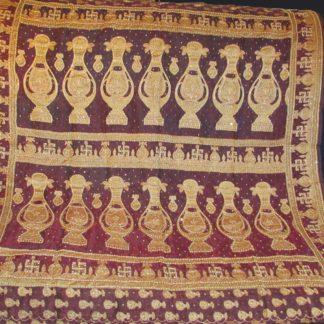 vintage silk sari pallu w/ swastika, kalash, beading, metal thread &sequins in burgundy and dark gold w/copper metallic thread, pearl beading, and sequins.