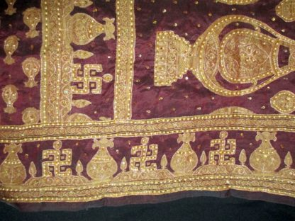 vintage silk sari pallu w/ swastika, kalash, beading, metal thread &sequins in burgundy and dark gold w/copper metallic thread, pearl beading, and sequins.